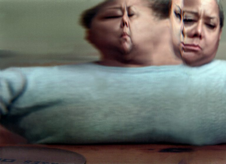 Blurred image of a woman showing her face from multiple angles
