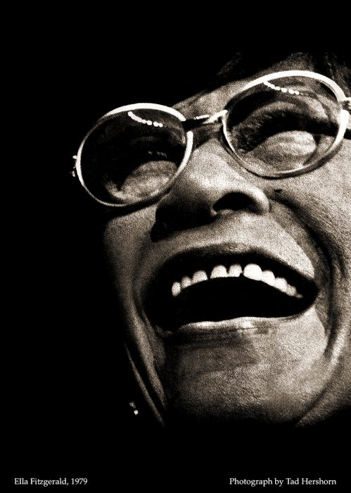 close up photograph of an older woman with glasses laughing