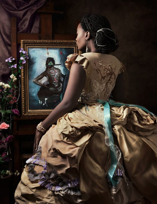 African American woman in a renaissance dress looking at a painting of an African American