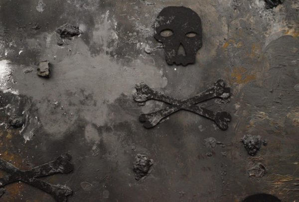 Heavily textured painting in blacks and grays of a skull and crossbones