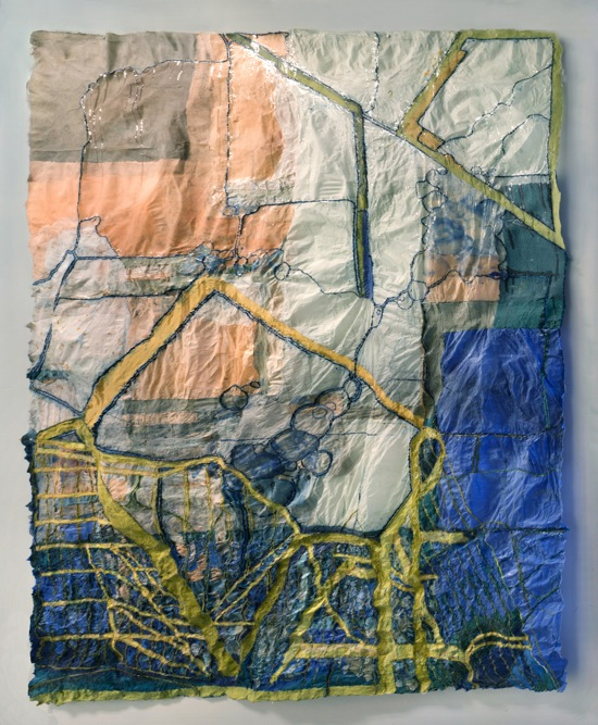 A square, textile based artwork, in blue, peach and yellow