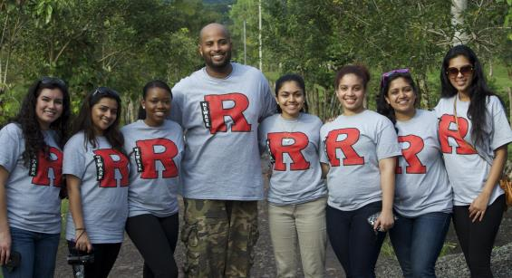 Group of students standing side by side wearing Rutgers t-shirts