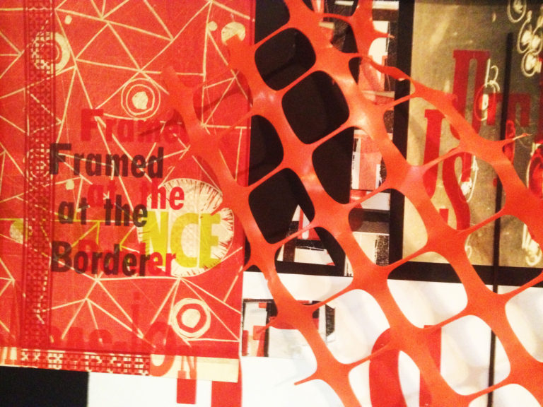 """A collage made with found images featuring the text, """"Framed at the border,"""" and orange plastic fence material"""