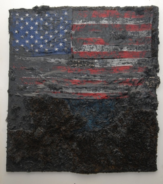 A painting of an American flag, barely visible because it is painted over in black