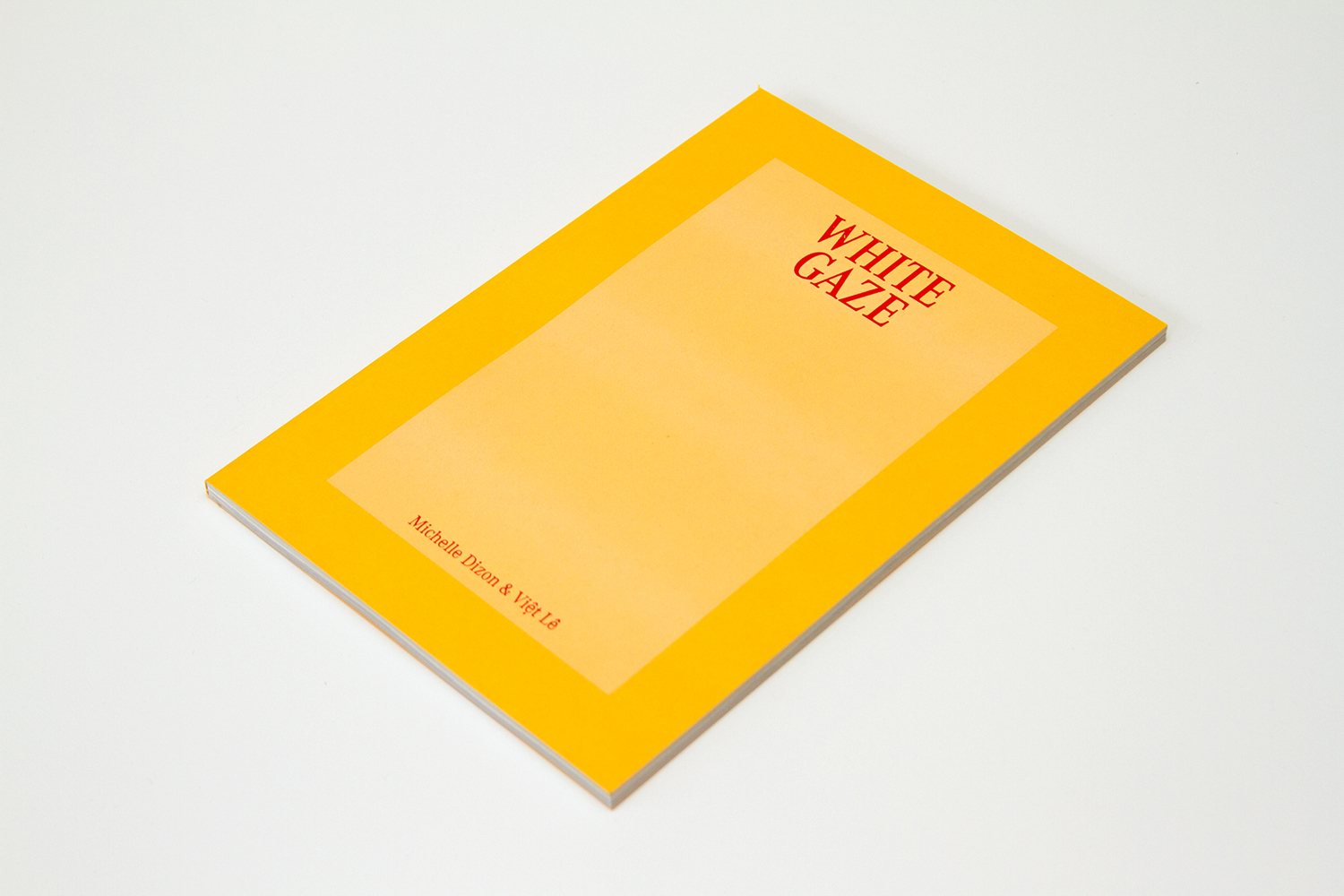 A yellow book with the title, White Gaze