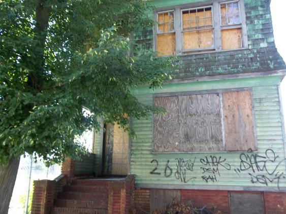 Photo of a boarded up house