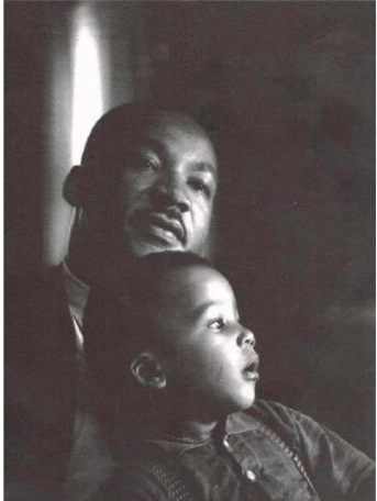 Photo of Martin Luther King, Jr. seated with child