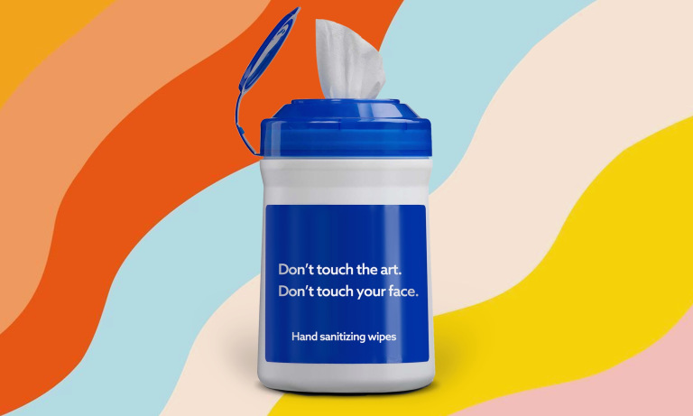 """A container of wipes with the text, """"Don't touch the art. Don't touch your face."""""""