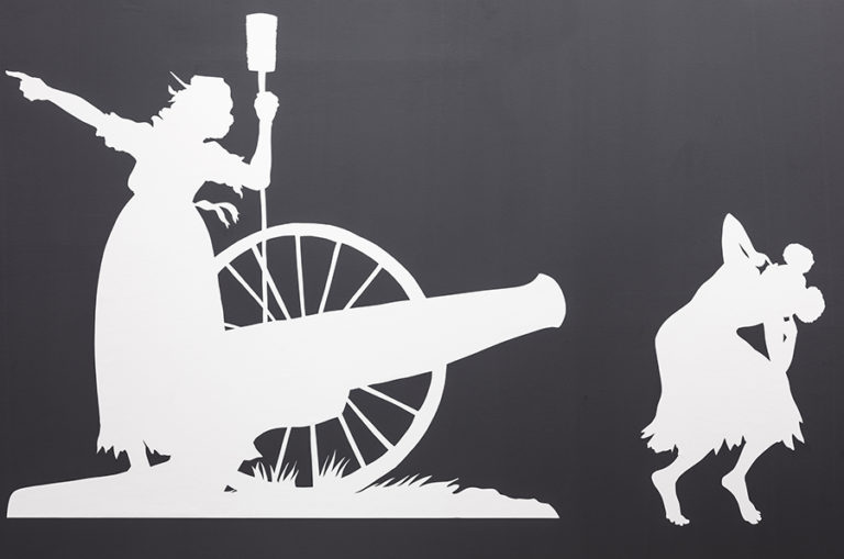 Shilhouets of two people: on crouching in front of a cannon, one standing and pointing away.