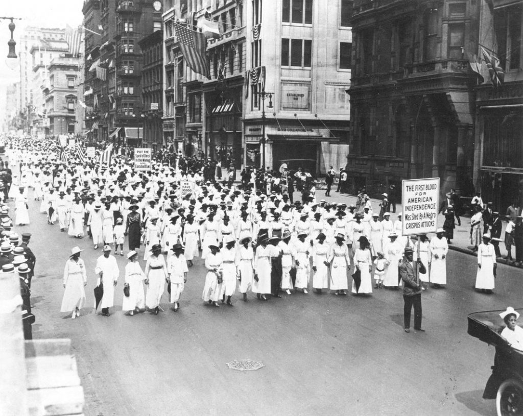 Black and white photograph of a protest against anti-Black violence.