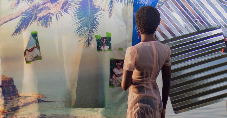 Photograph of a women infront of art